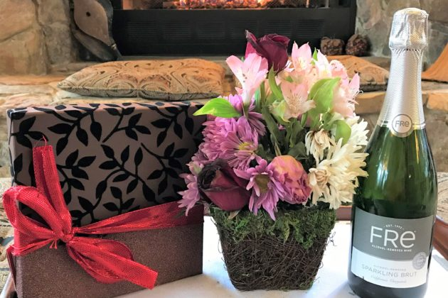 Deluxe celebration package with flowers chocolate truffles and non-alcoholic sparkling wine
