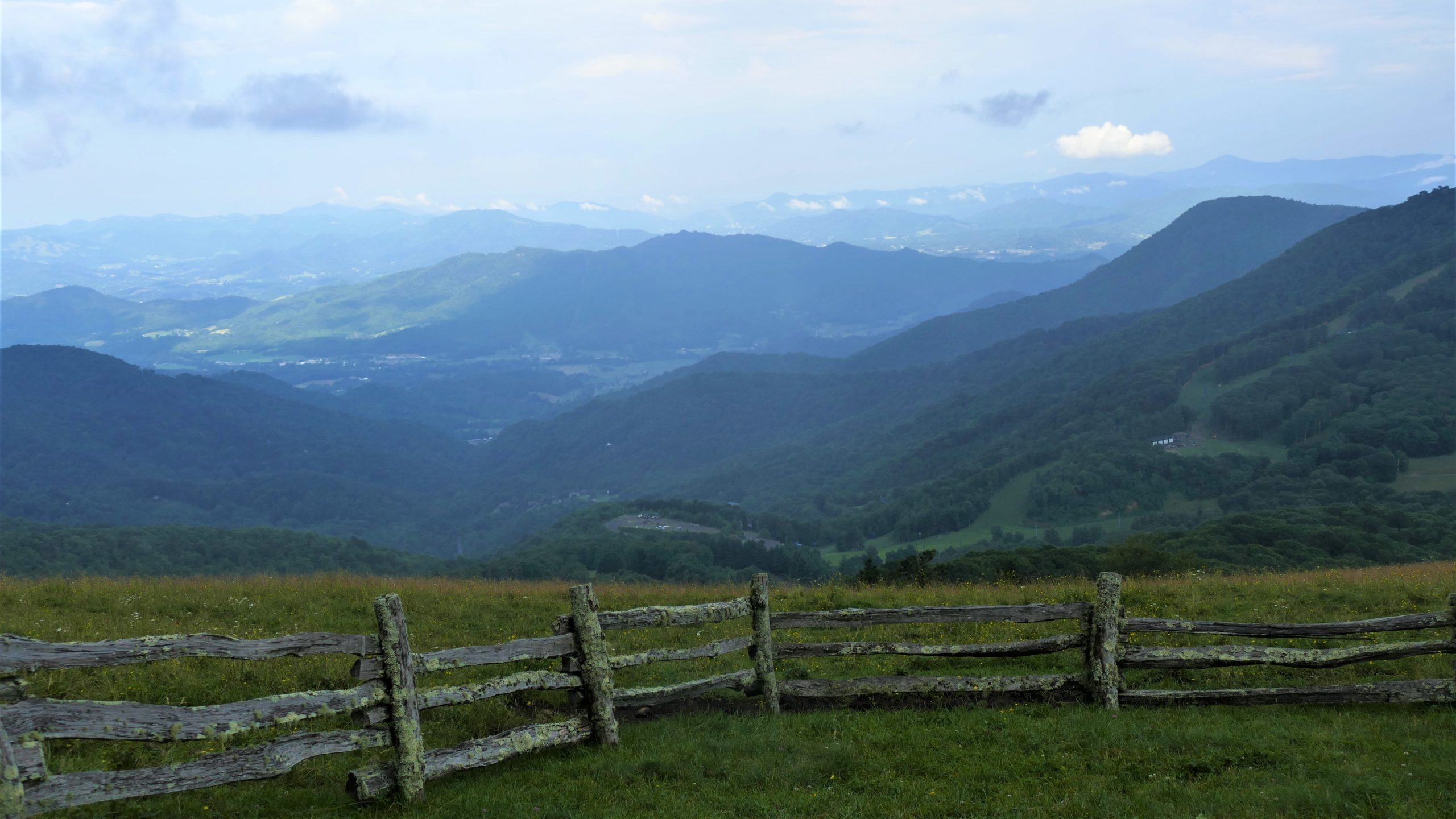 Panormaic view of mountains and split rail fence seen from Hemphill Bald