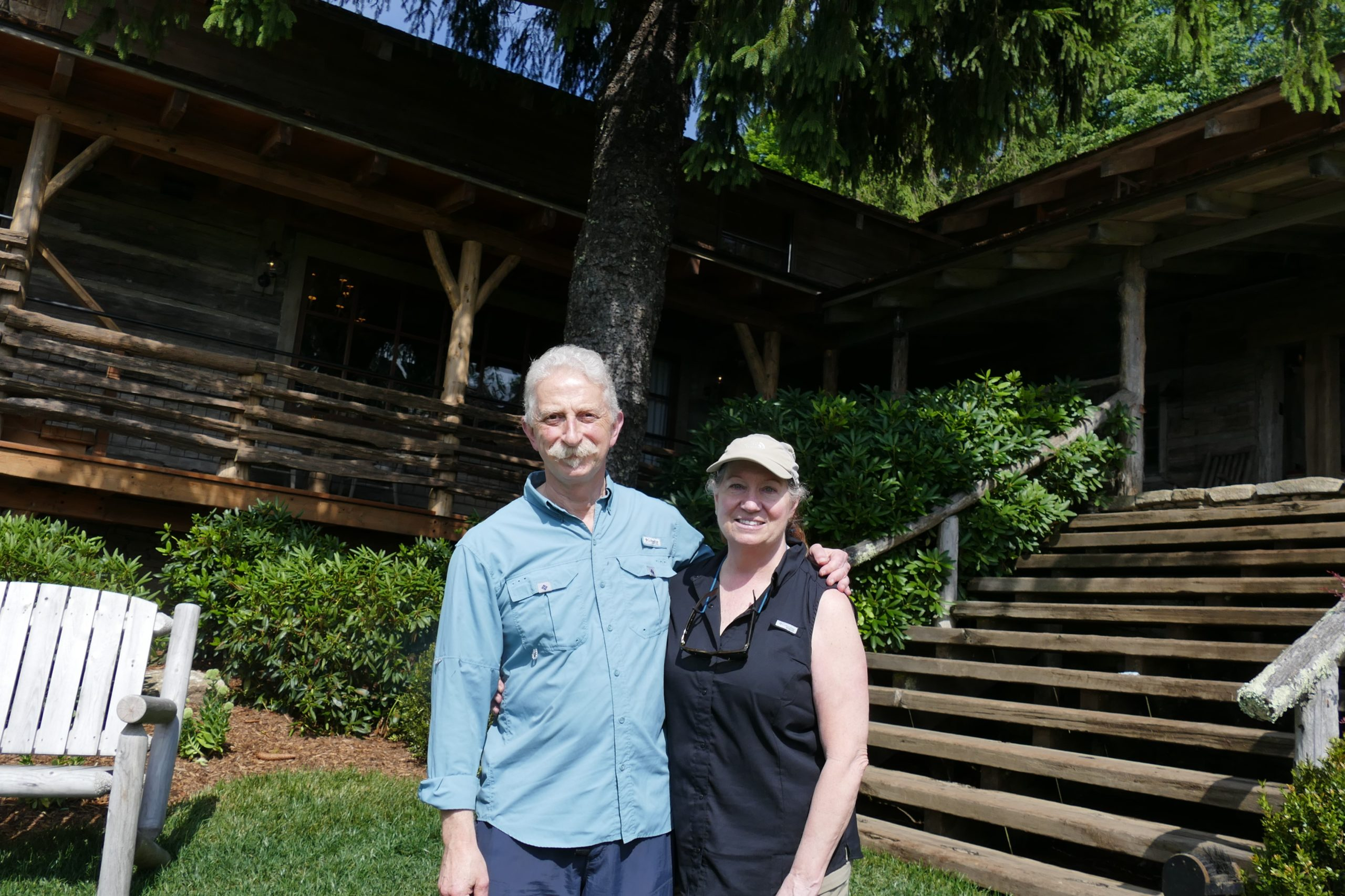 Andrea and George standing by the steps of the Swag resort