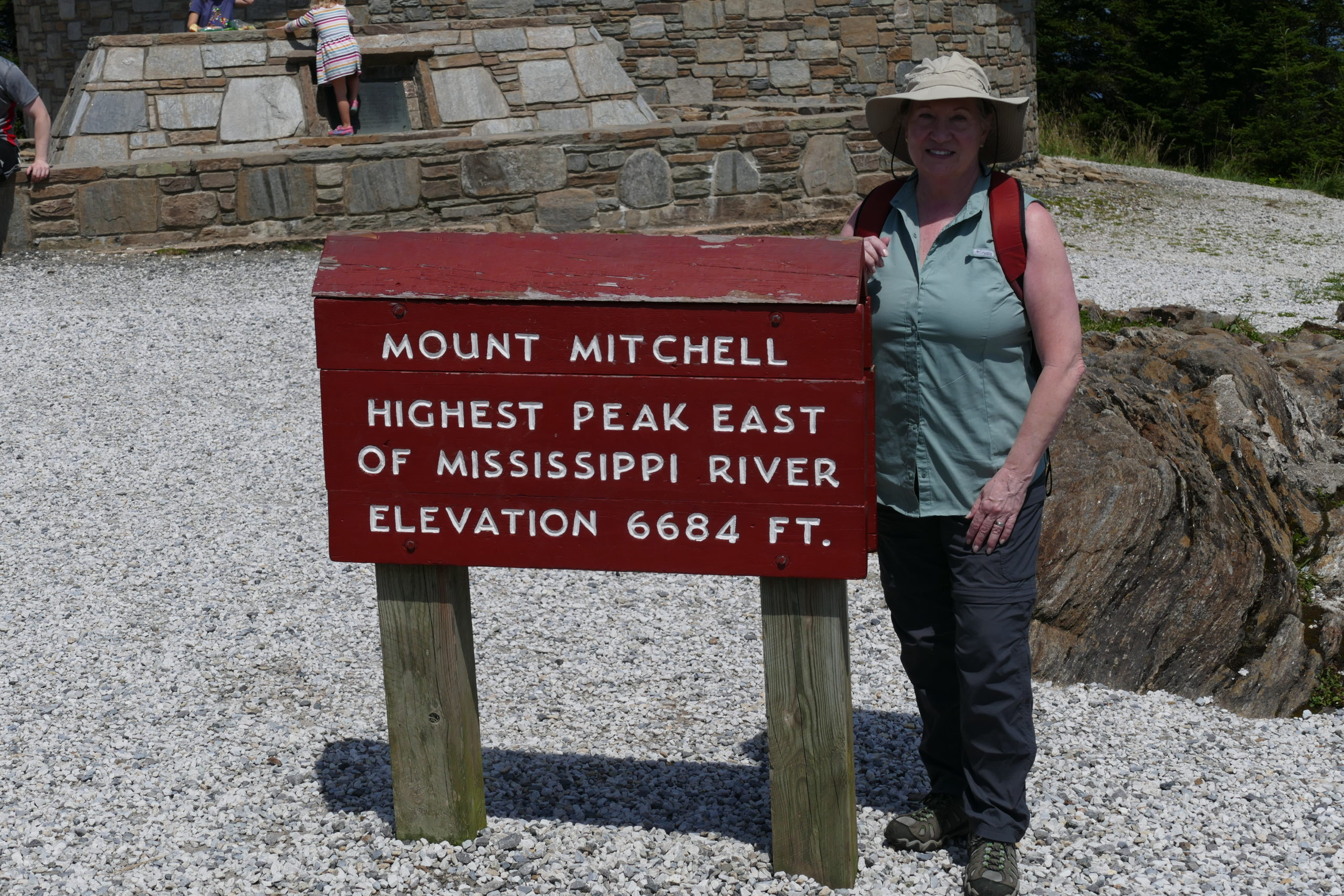 Andrea standing next to Mt Mitchell elevation sign