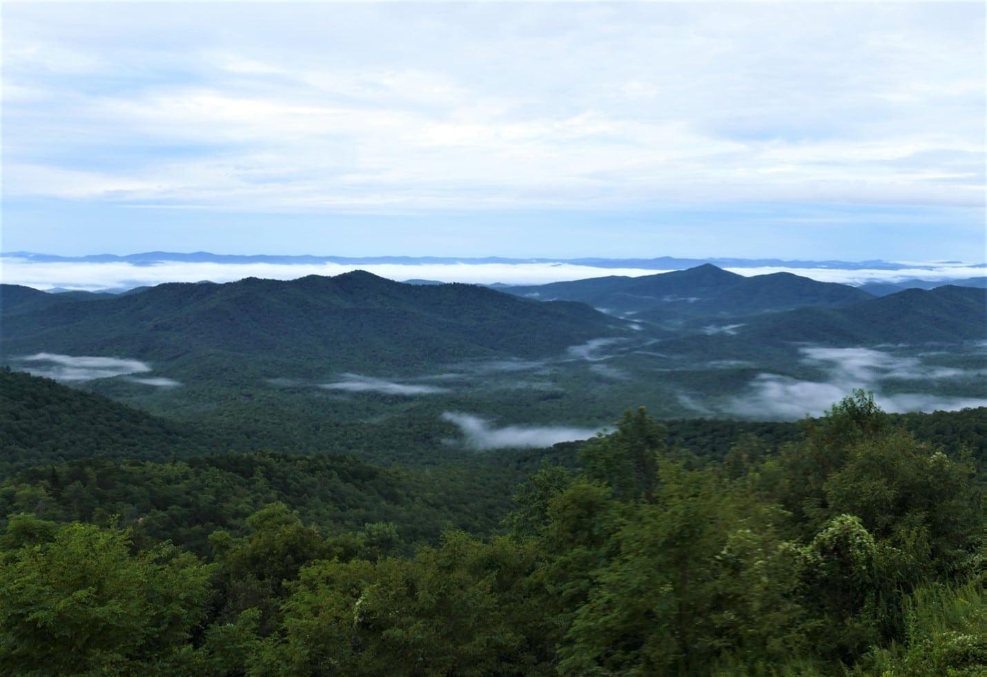 View of misty Blue Ridge Mountains from Pisgah Inn terrace