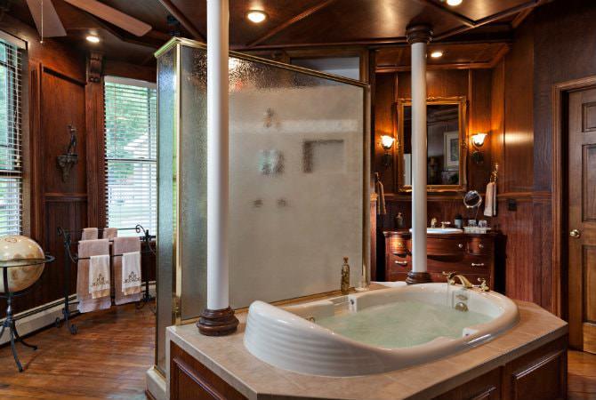 Wood paneled bathroom, walk-in shower, soaking tub, lots of natural light