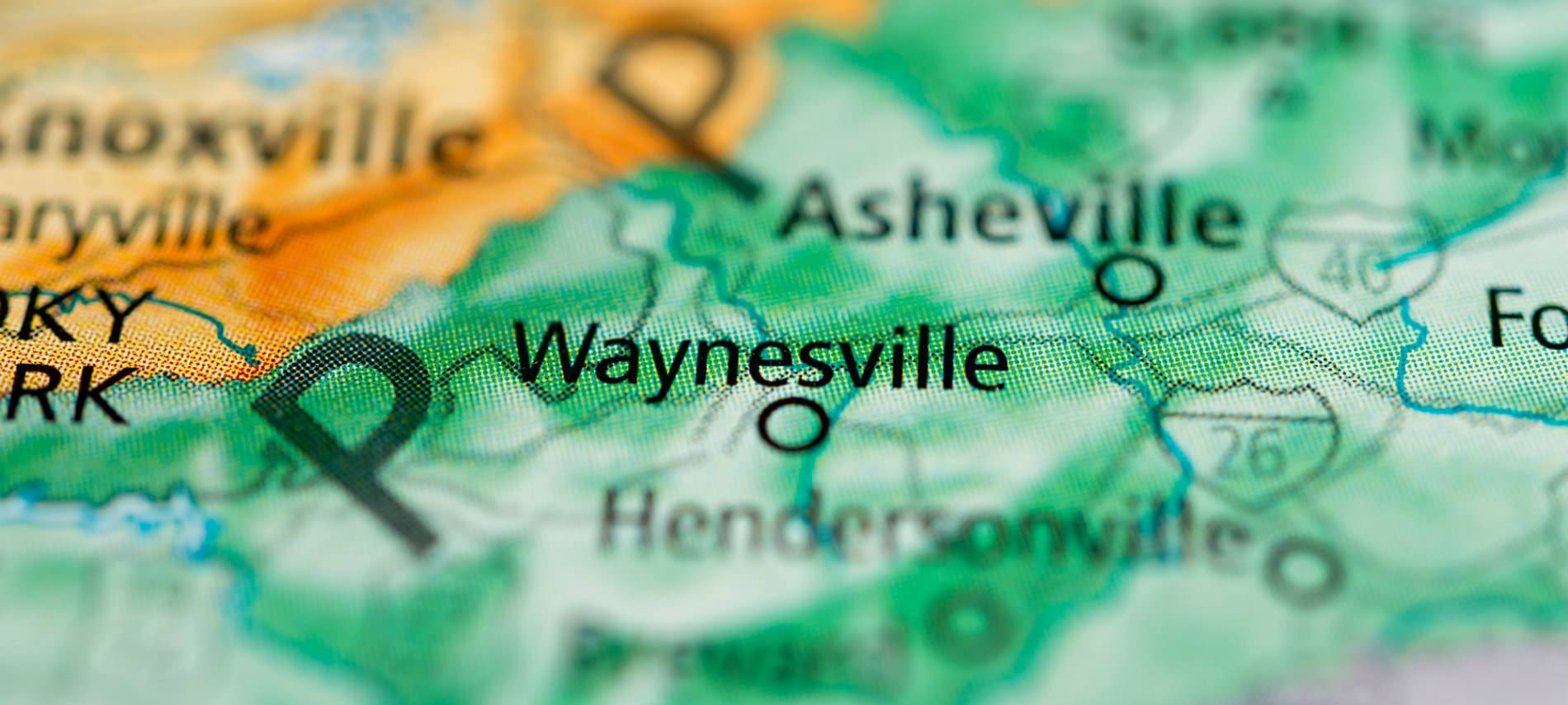Close up view of a yellow and green shaded map of Waynesville, NC and the surrounding towns