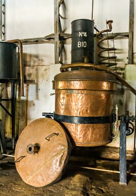 Copper barrel with black metal banding for wine making
